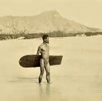 Late 19th century surfer in Hawaii holding an Alaia board wearing a Malo, or traditional loincloth.